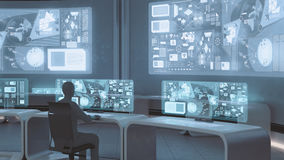 3D rendered, modern, futuristic command center interior with people Royalty Free Stock Image