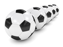 3d rendered row of soccer balls isolated over white. Background Stock Image