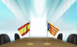 Spain and Catalonia political relations and unity talks, 3D rendering. 3D rendered scene of miniature flags from Spain and Catalonia at a table for diplomatic Royalty Free Stock Images