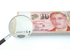 3D Rendered Singapore money with magnifier investigate currency  on white background Royalty Free Stock Photography