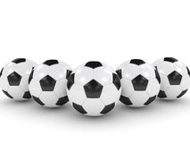 3d rendered soccer balls isolated over white. Background Royalty Free Stock Images
