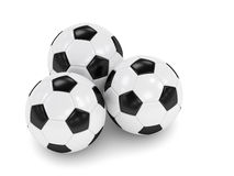3d rendered three soccer balls isolated over white. Background Royalty Free Stock Images