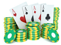 3d renderer image. Green casino tokens and Playing Cards. Stock Photo