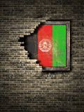 Old Afghanistan flag in brick wall. 3d rendering of an Afghanistan flag over a rusty metallic plate embedded on an old brick wall Royalty Free Stock Image
