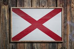 Wooden Alabama flag. 3d rendering of an Alabama State USA flag on a wooden frame and a wood wall Royalty Free Stock Photos