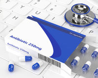3d rendering of antibiotic pills in blister pack and stehoscope. Lying on computer keyboard Stock Photos