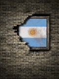 Old Argentina flag in brick wall. 3d rendering of an Argentina flag over a rusty metallic plate embebed on an old brick wall Royalty Free Stock Images