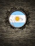 Old Argentina flag in brick wall. 3d rendering of an Argentina flag over a rusty metallic plate embedded on an old brick wall Royalty Free Stock Photos