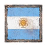 Old Argentina flag. 3d rendering of an Argentina  flag over a rusty metallic plate in an old frame. Isolated on white background Royalty Free Stock Images