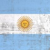 Scratched Argentina flag. 3d rendering of Argentina flag in a scratched surface Stock Photos