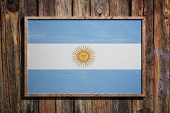 Wooden Argentina flag. 3d rendering of Argentina flag on a wooden frame over a planks wall Royalty Free Stock Image