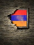 Old Armenia flag in brick wall. 3d rendering of an Armenia flag over a rusty metallic plate embedded on an old brick wall Royalty Free Stock Photography