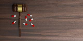 3d rendering auction gavel with pills Stock Image