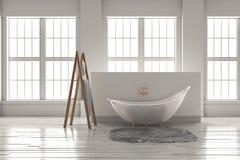 3D-rendering av ett badkar på ett trägolv framme av stora wi Arkivfoto
