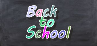 3d rendering Back to school on a black chalkboard Royalty Free Stock Image