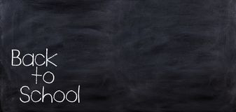 3d rendering Back to school on a black chalkboard Stock Images