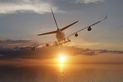 3d rendering from a back view of a big airliner in a sunset over the ocean Royalty Free Stock Images