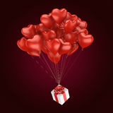3D rendering balloons. 3D rendering a bunch of red balloons with a gift Stock Images
