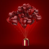 3D rendering balloons. 3D rendering a bunch of red balloons with a gift Royalty Free Stock Images