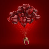 3D rendering balloons. 3D rendering a bunch of red balloons with a gift Stock Image