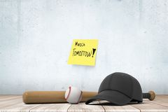 3d rendering of baseball bat, ball and black cap, lying on wooden floor near wall with yellow sticky note that reads