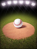 3d rendering of a Baseball on a pitchers mound of Lighted Baseball field. Room for text or copy space Stock Image