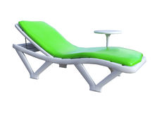 3D Rendering Beach Chair and Table on White. 3D rendering of a beach chair and a table isolated on white background Royalty Free Stock Photo