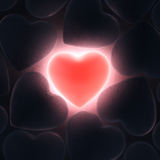 3D rendering beautiful glowing heart. On a dark background Royalty Free Stock Image