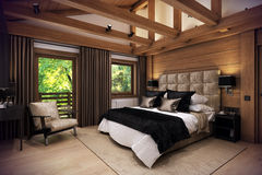 3D rendering bedroom house in the mountain. 3D rendering cozy bedroom is in the attic of a chalet. Huge bed with numerous pillows is dominates the room. The Royalty Free Stock Photography