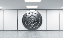 3D rendering of a big locked round metal safe in a bank deposito Royalty Free Stock Photography