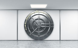 3D rendering of a big locked round metal safe in a bank deposito Royalty Free Stock Photo
