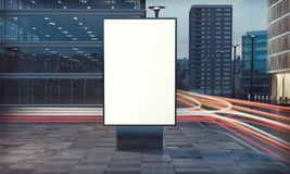 Blank billboard on the street. 3d rendering of billboard blank for outdoor advertising with long exposure road light trails Royalty Free Stock Photos