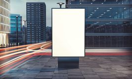 Blank billboard on the street. 3d rendering of billboard blank for outdoor advertising with long exposure road light trails Stock Images