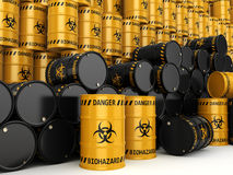 3D rendering biohazard barrels. 3D rendering yellow and black barrels with biologically hazardous materials Royalty Free Stock Images