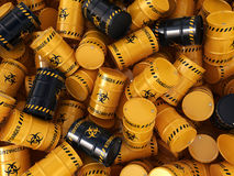 3D rendering biohazard barrels. 3D rendering yellow and black barrels with biologically hazardous materials Royalty Free Stock Photo