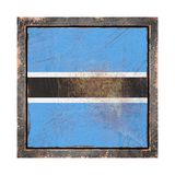 Old Botswana flag. 3d rendering of a Botswana flag over a rusty metallic plate wit a rusty frame. Isolated on white background Stock Photos