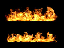3d rendering of bright orange fire flames in two rows on black background. Royalty Free Stock Image