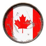Old Canada flag. 3d rendering of a Canada flag over a rusty metallic plate. Isolated on white background Royalty Free Stock Photos