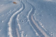 3d rendering of car and foot prints on snow. With snow leds Royalty Free Stock Images