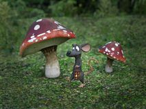 3D rendering of a cartoon mouse in a fairytale mushroom forest. Royalty Free Stock Image