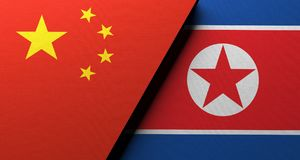 China Vs North Korea Flag Concept. 3D Rendering Of China Vs North Korea Flag Concept Cloth Texture Royalty Free Stock Photography
