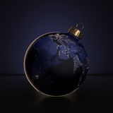 3D rendering Christmas ball Planet Earth at night lighting Royalty Free Stock Images
