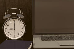 3D rendering of a clock, laptop and book for studies for works Royalty Free Stock Photos
