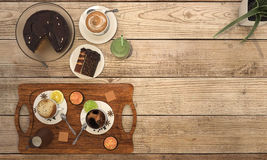 3d rendering coffee set with chocolate cake on wooden table. 3d design and rendering  by 3dsmax Stock Image