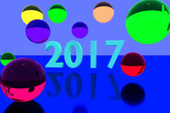 3D rendering of colorful glass balls on reflective surface and the year 2017. In big numbers Royalty Free Stock Images