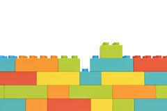 3d rendering of colorful wall made of many toy bricks with one piece staying unused on white background. Games and toys. Puzzle pieces. Building blocks Stock Photos