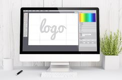 White workspace with computer logo design. 3d rendering computer logo design on computer. All screen graphics are made up stock photography