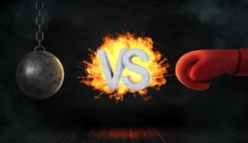 3d rendering of a concrete letters VS caught on fire between a wrecking ball and a red boxing glove. Sport and danger. Active pastime. Strength and force Stock Photos