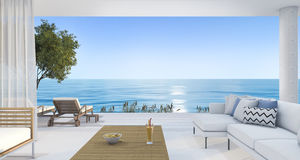 3d rendering contemporary nice living room near beach and blue sky Royalty Free Stock Photos