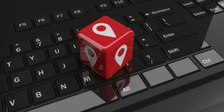 3d rendering cube with location symbol on a keyboard. 3d rendering cube with location symbol on a black keyboard Royalty Free Stock Photography